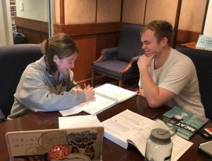 A student being tutored while studying for their MCAT