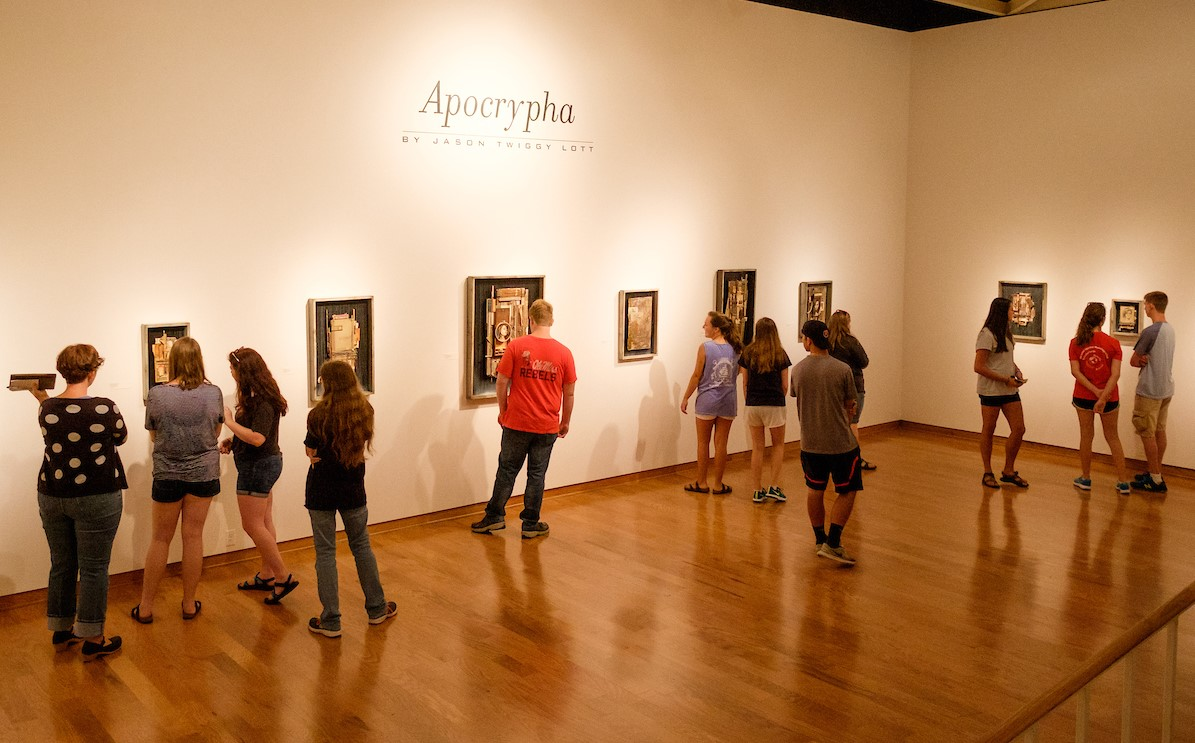 Students viewing art in the UM Museum gallery.