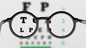 iage of glasses and an eye chart
